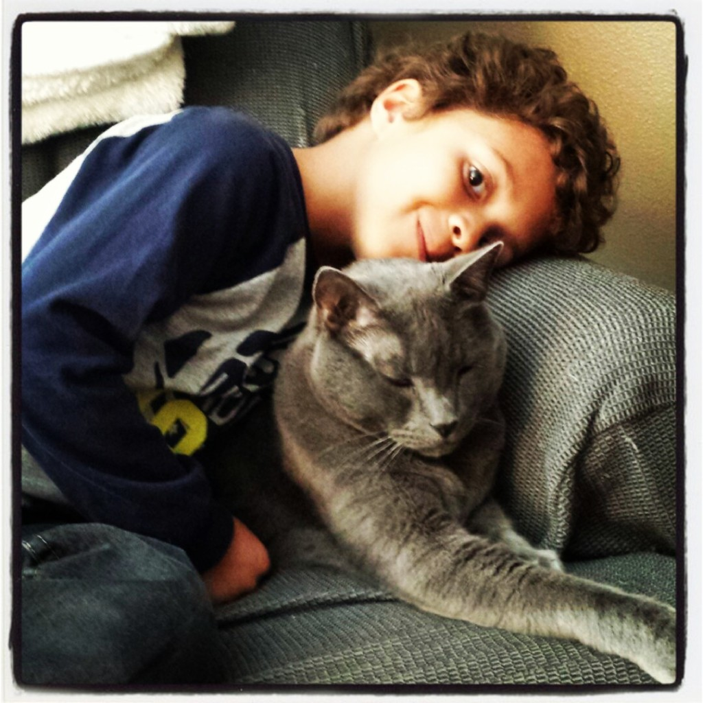 Logan loves snuggling with Gimley, our friend's pet.