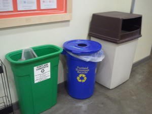 In Portland a trash bin rarely stands alone. It's usually accompanied by a recycling bin, or like here, a compost bin.