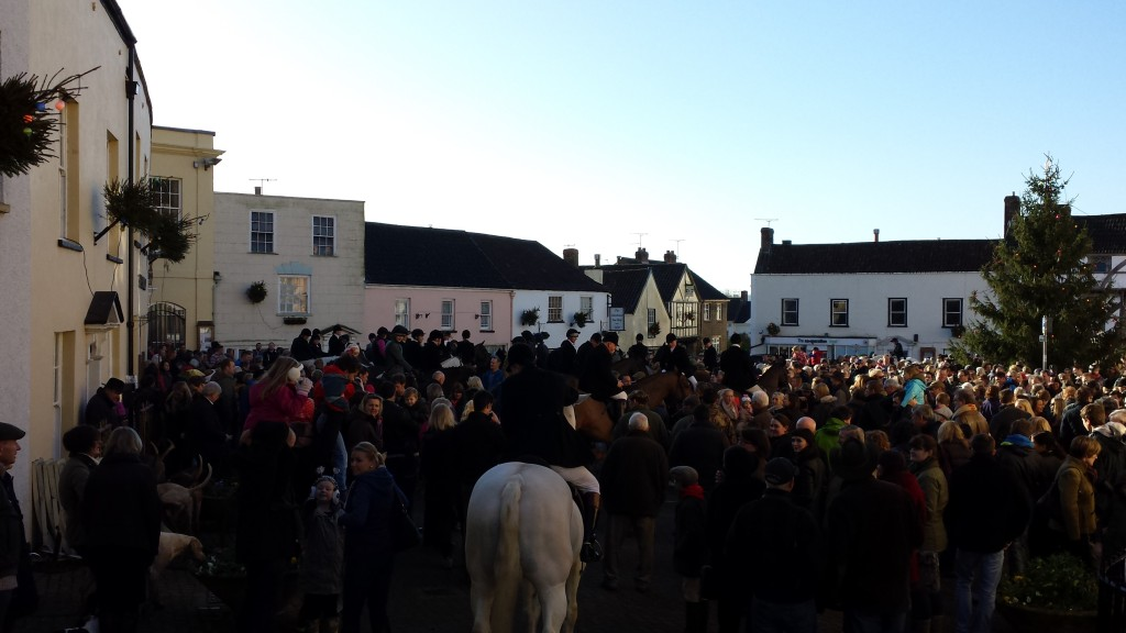 Gathering in the square to see off the hunters.