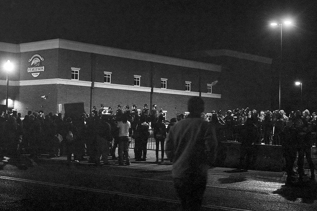 Protests in front of the Ferguson Police Department a few days after the grand jury chose not to indict then-officer Darren Wilson in Michael Brown's death. Photo by Mike Tigas.